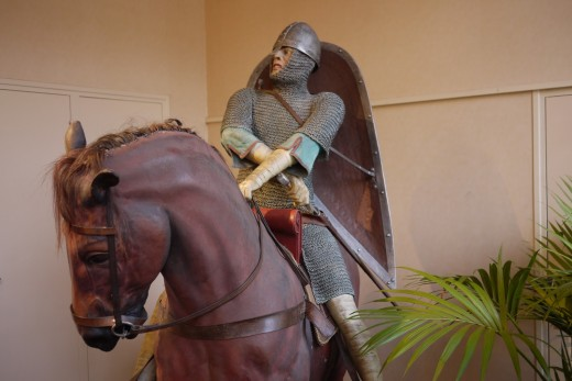 Mounted Norman in the museum, shield hanging on his back by strap