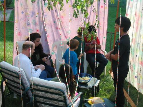 Celebrating Sukkot in the sukkah