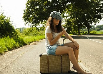 This pretty hitchhiker is in danger of mean people