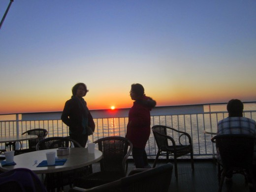 Me and my new friend Brigitte, watching the sunset having a drink at the view deck while sailing to St Petersburg.Aboard St Peter Line's Princess Maria.