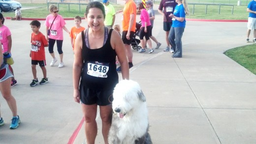 Walter's girlfriend and their dog, bear in a 5K race for charity.