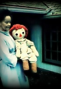 Loraine Warren carrying the real Annabelle, which was a Raggedy Anne doll.