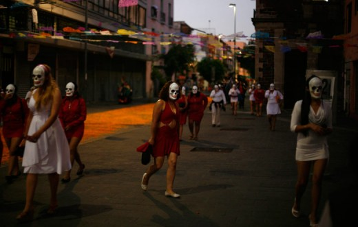 """Sex workers wearing skeleton masks gather in Mexico city for a procession to remember their deceased colleagues."" This is serious stuff."