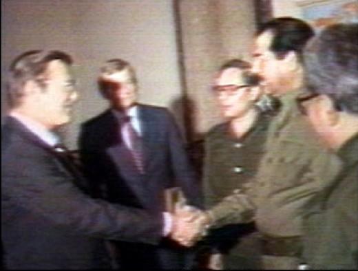 Saddam Hussein shaking hands with Donald Rumsfeld, 1983