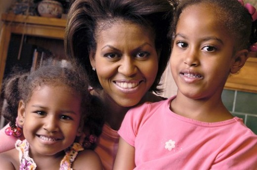 http://barackobamaphotos.files.wordpress.com/2009/01/michelle-obama-with-daughters.jpg
