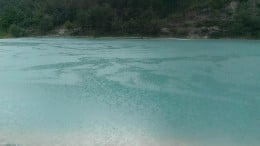 Clear emerald waters of Lan Yue Gu in Lijiang, Yunnan.