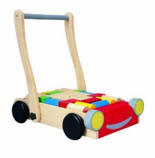 Plan Toys Eco Baby Walker - Your toddler will love pushing and pulling this wooden baby walker with blocks. Includes 24 blue, yellow, red green and natural blocks. Handle can be adjusted for two heights.