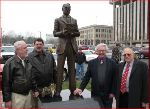 This statue of David Buick Dunbar was erected in his honor in 2012. Left to right: Doug Boes, the great-grandson of David Buick; Kevin Kirbitz, sculpture creator Joe Rundell of Clio, Michigan; and veteran Buick publicist/historian Lawrence R. Gustin.