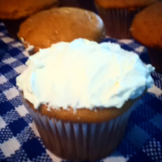 A cupcake without frosting is just a muffin. So smooth on some cream cheese frosting and your Pumpkin Spice Cupcakes are done! Yum!