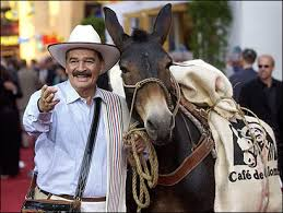 """Juan Valdez"" and ""Conchita"" greet people in the market place"