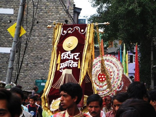 PEOPLE CARRYING GODS AND GODESSES IN PALANQUINS