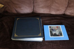 Large old fashioned album on left, photo book on the right.