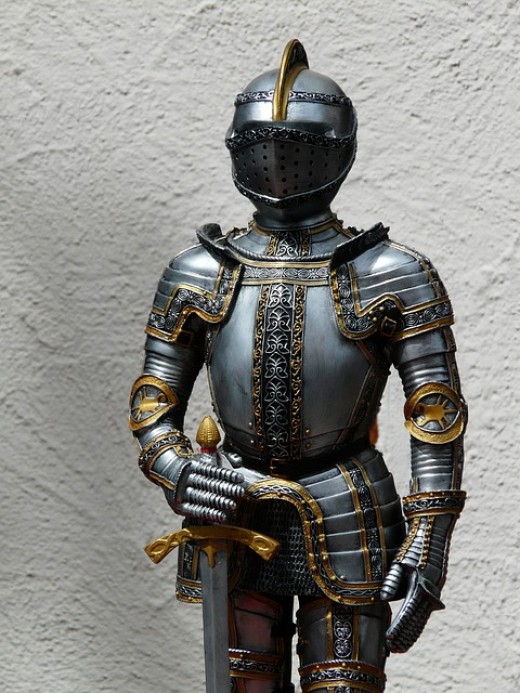 Suit of armor.  This was the main form of protection for people in wars for many centuries.  Nowadays, soldiers are more likely to use armored vehicles for protection when moving around the battlefield.
