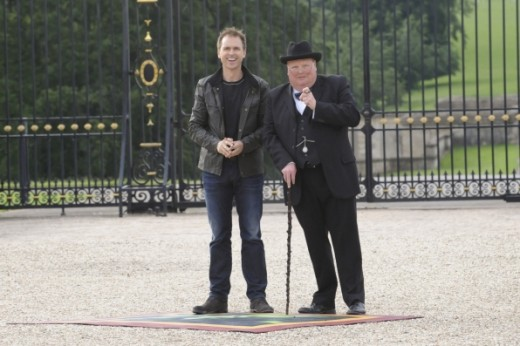 Hos Phil Keoghan waitis with a Winston Churchill impersonator.