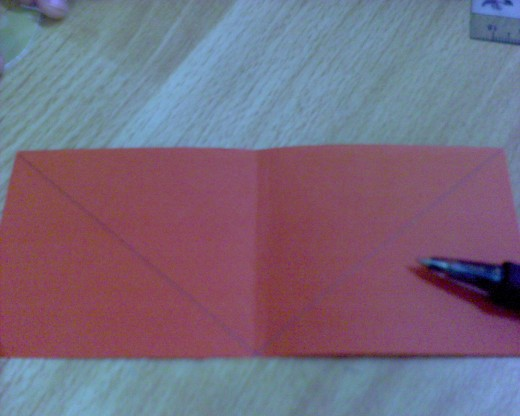 Use ruler to draw an upside down triangle, with the same measurement of the handbag opening