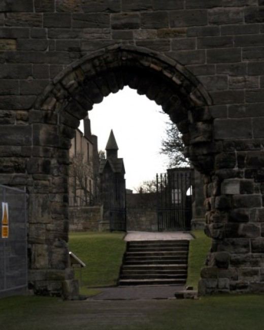 framed shot of St Andrews Cathedral spoiled by metal grating on the left
