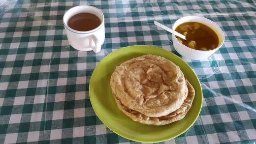 Puri Bread and Potato Curry With Tea