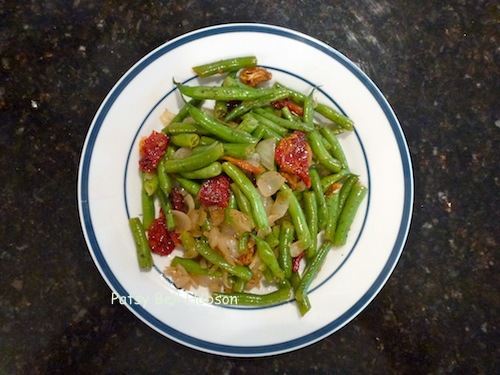 Added early to the cooking green beans, the dried tomatoes absorb the vitamin enriched cooking liquid and flavor.