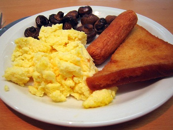 This version of the English breakfast has fried bread on the right hand side of the plate.