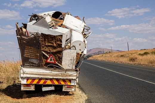 Truck carrying scrap iron.  Many common materials can be recycled including metal, paper, and glass.  Much domestic recycling used to be done on a purely voluntary basis, but is now increasingly being adopted by local government agencies.