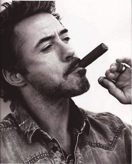 Robert Downey Jr sporting attitude and a cigar