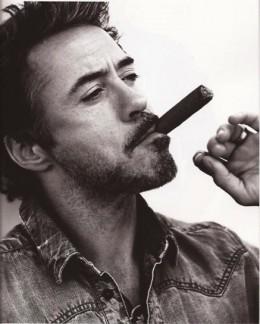 Robert Downey Jr sporting attitude and a cigar