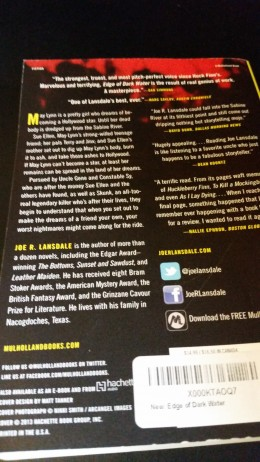 Photo of the back cover of my personal copy of Edge of Dark Water by Joe R. Lansdale.