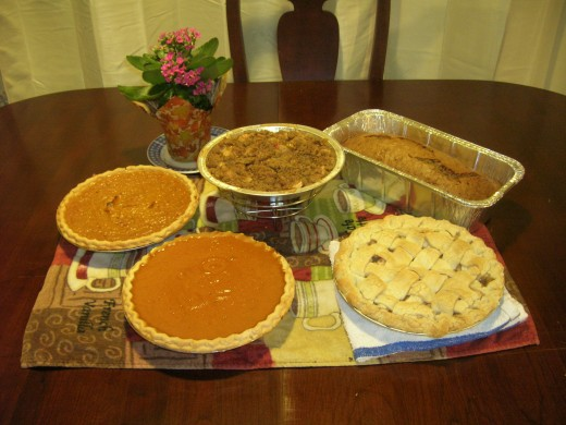 Holiday pies!  Clockwise from the lattice top apple pie, pumpkin pie, sweet potato pie, apple crisp, and a banana nut bread for good measure.