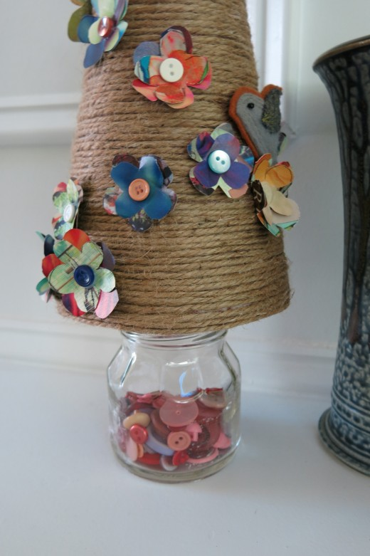 Use a jar filled with buttons for the base of your tree decoration!