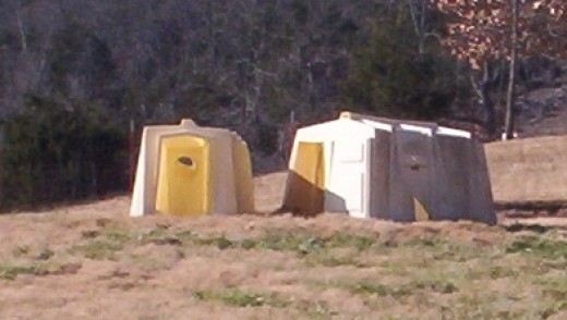 Portable, polyvinyl, calf hutches work well for small groups of goats. The ones pictured above are used for bucks.
