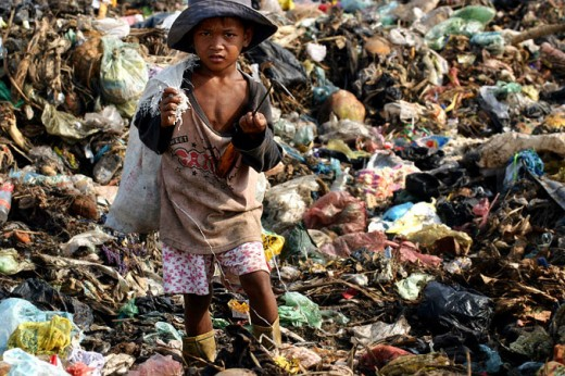 Cambodian child scavenging in dump