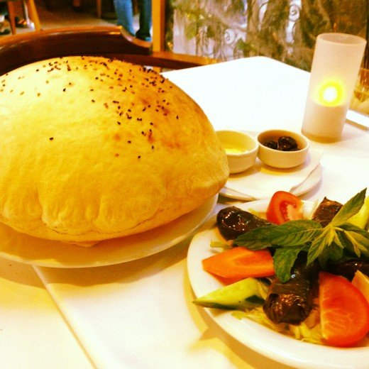 Turkish Bread- Hollow in the middle perfect to scoop up food, along with an order of dolma (Stuffed grape leaves with rice and beef)