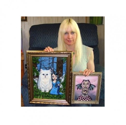 """A Fairy Cat Friend"" and ""Gothic Bat Fairy"" by Lindsey Cormier.  Lindsey does such incredible work! I especially love the big white kitty fairy! Lindsey's lovely work is also featured in the book, Big Eye Art: Resurrected and Transformed."