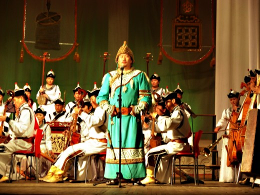 "Mongolian throat singer in a traditional ""deel"" outfit."