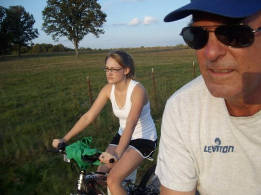 The author biking with her father, 2008.
