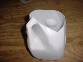 Cut off Plastic Milk Jug for catching water from tank