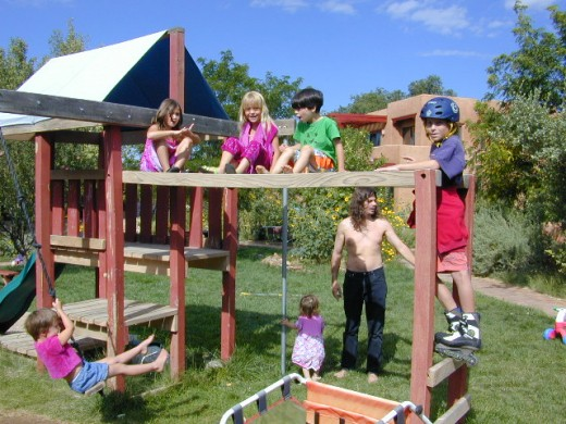 Children playing in the park-like community playground - Used with permission