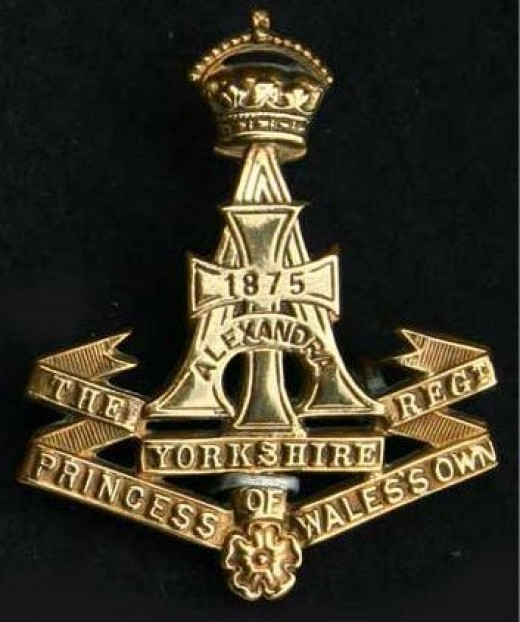 "Green Howards cap badge, in full the regiment is ""The Yorkshire Regiment, Alexandra, Princess of Wales Own"" (Alexandra was the Danish princess married to Victoria's son Edward, from 1901 Edward VII)"