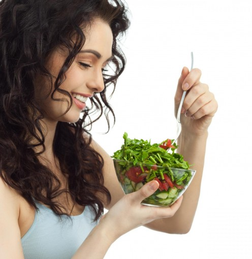 Beautiful woman eating healthy