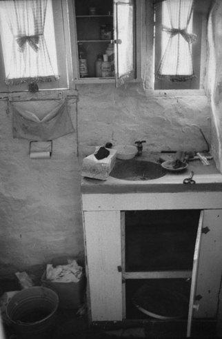 Bathroom vanity where Charles Manson hid