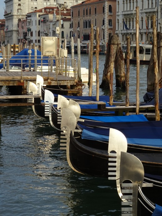 Gondolas at peace waiting for the day to begin