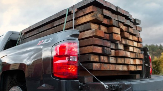 2015 Chevy Silverado Z71 with a load of wood in the bed photo