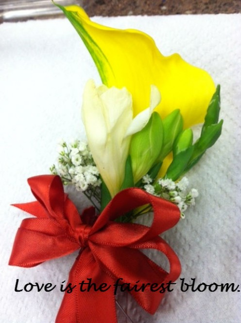 Rob's boutonniere with yellow calla lily, freesia and gysophilia.