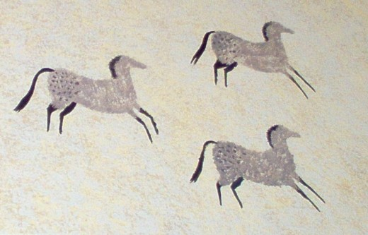 Sponge painted horses on a wall