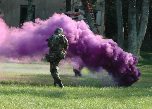 A violet smoke grenade being put to use at an airsoft match