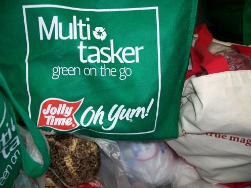 "Reusable ""free"" bag next to canvas bookstore bag."