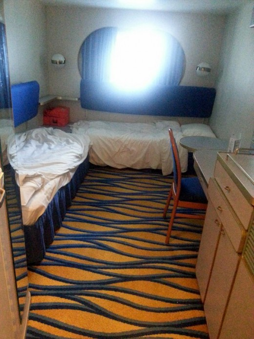 Our cabin with L-shaped bed setup on Superstar Libra. Apologies for the messy beds!