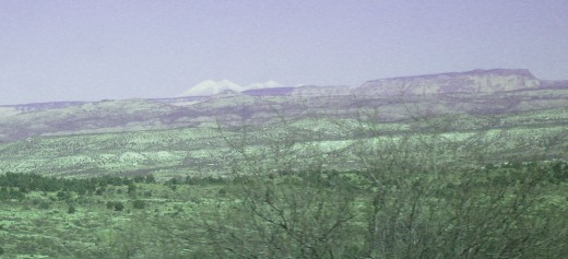 Enhanced view of the distant, snow covered San Francisco Peaks.