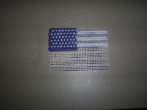 Start cross stitch the white rows on the flag.