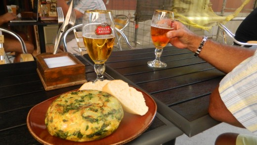 Spanish omelette is delicious + filling. Make sure you try different dishes not just British Food